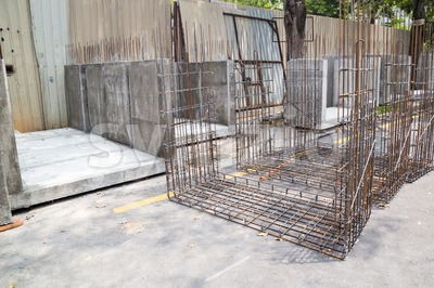 Metal rebar and concrete casted drain blocks at construction site Stock Photo