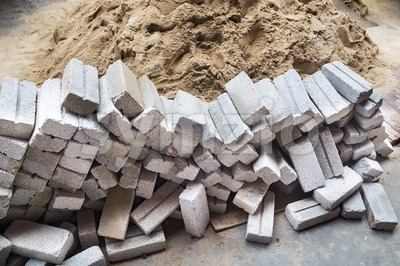 Light weight and cheap sand bricks at construction site Stock Photo