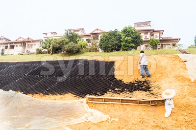 Slope erosion control with grids and earth on steep slope Stock Photo