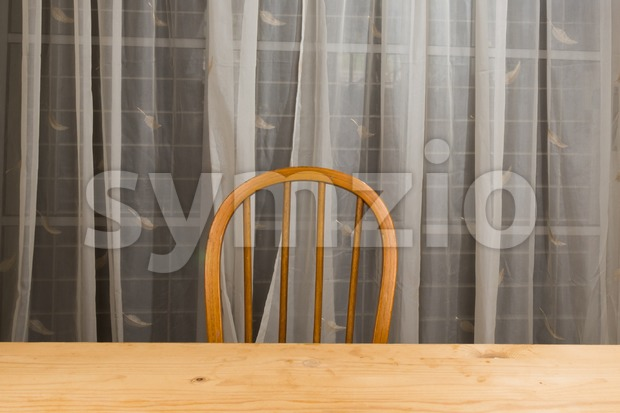 Wooden dining table and chair with nobody. Stock Photo