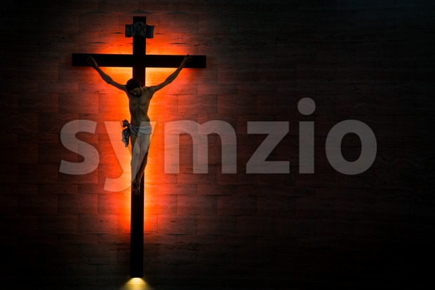 Catholic Christian Crucifix in silhouette flushed left. Stock Photo