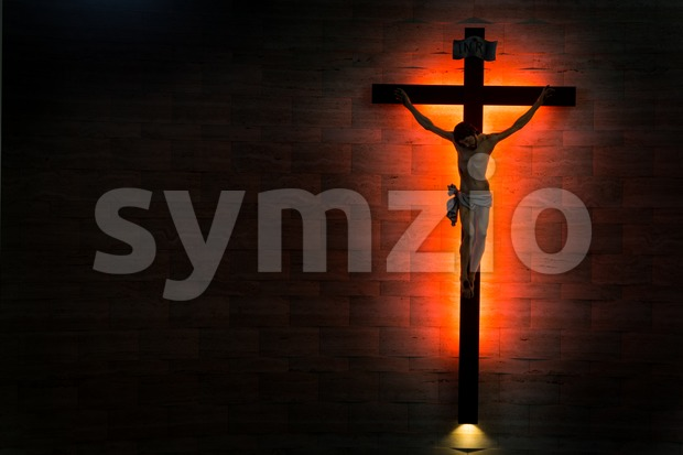 Catholic Christian Crucifix in silhouette flushed right. Stock Photo