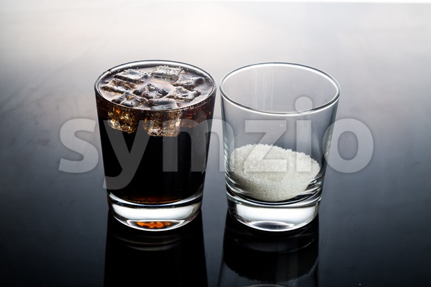 Concept of fizzy cola drinks with unhealthy sugar content.