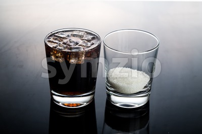 Concept of fizzy cola drinks with unhealthy sugar content Stock Photo