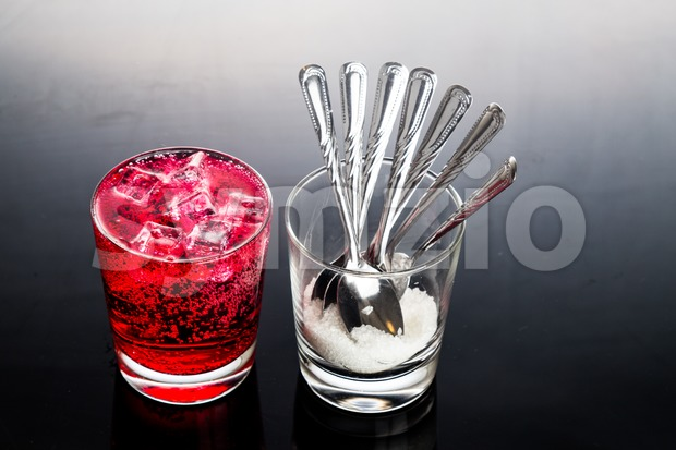 Concept of red fizzy drinks with unhealthy sugar content Stock Photo