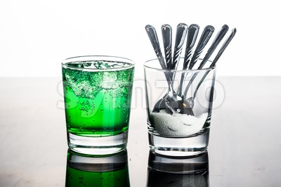 Concept of green fizzy drinks with unhealthy sugar content Stock Photo