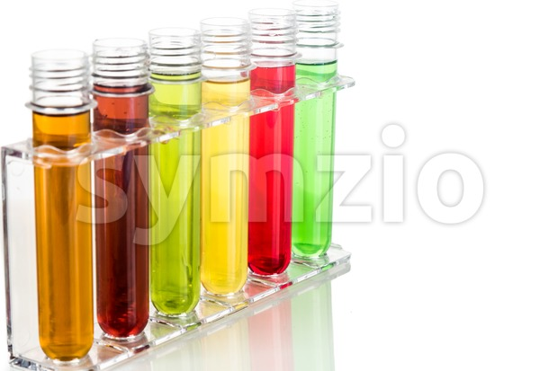 Test tubes with multi color chemicals isolated in white Stock Photo