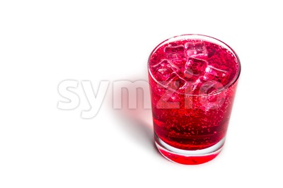 Refreshing red fizzy soft drink with ice in transparent glass Stock Photo