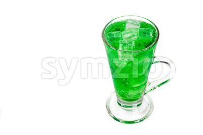Refreshing green fizzy soft drink with ice in transparent glass Stock Photo