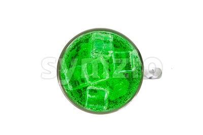 Refreshing green fizzy soft drink with ice in transperant glass Stock Photo