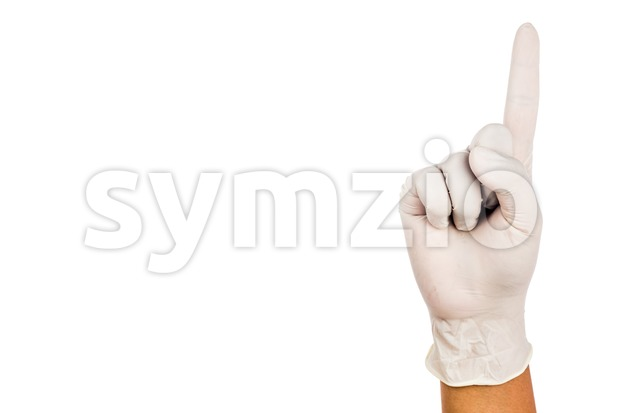 Hand in surgical latex glove gesture number One Stock Photo
