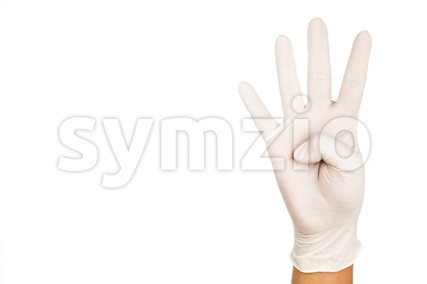 Hand in surgical latex glove gesture number Four Stock Photo