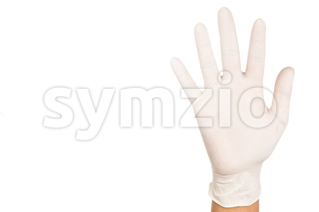 Hand in surgical latex glove gesture number Five Stock Photo