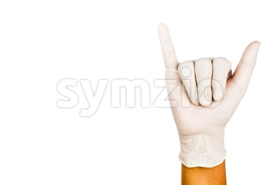 Hand in surgical latex glove gesture number Six Stock Photo
