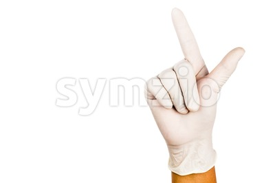 Hand in surgical latex glove gesture number Seven Stock Photo