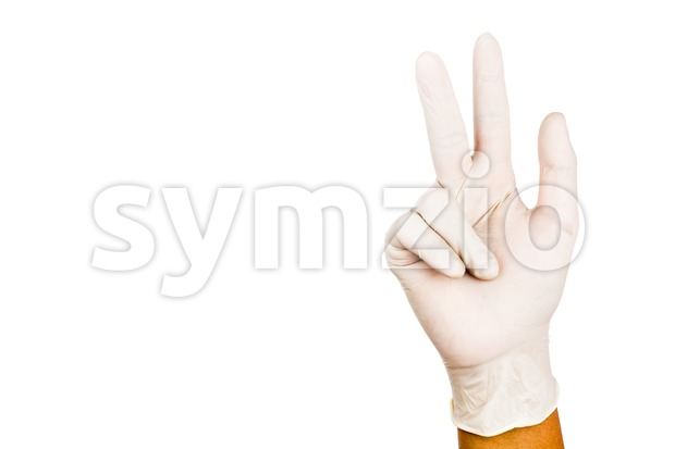 Hand in surgical latex glove gesture number Eight Stock Photo