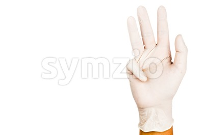 Hand in surgical latex glove gesture number Nine Stock Photo
