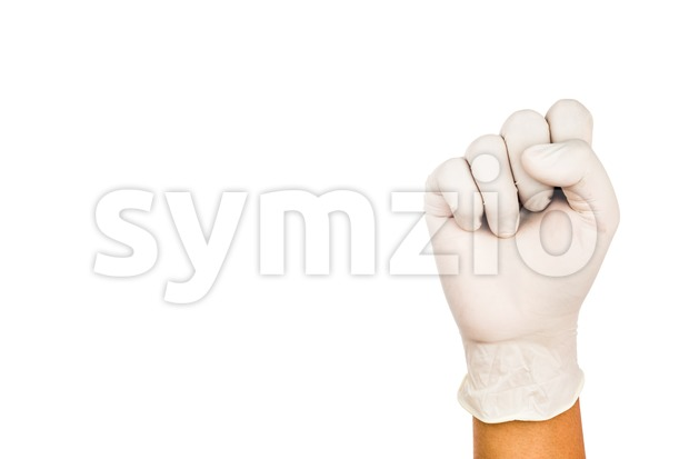 Hand in surgical latex glove gesture number Ten Stock Photo
