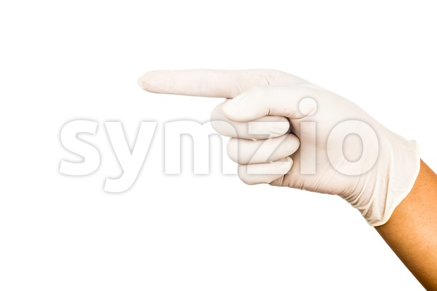 Hand in surgical latex glove pointing against white background Stock Photo