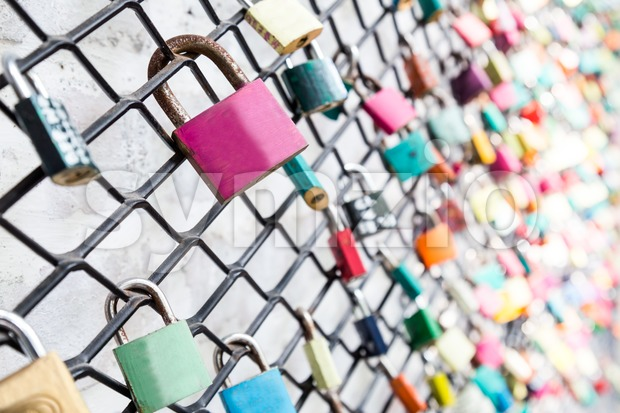 Many love locks on fence concept with selective focus on a blank lock at foreground Stock Photo