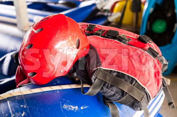 Safety helmet and life jacket, essential safety kit for canoeing and kayaking activities Stock Photo