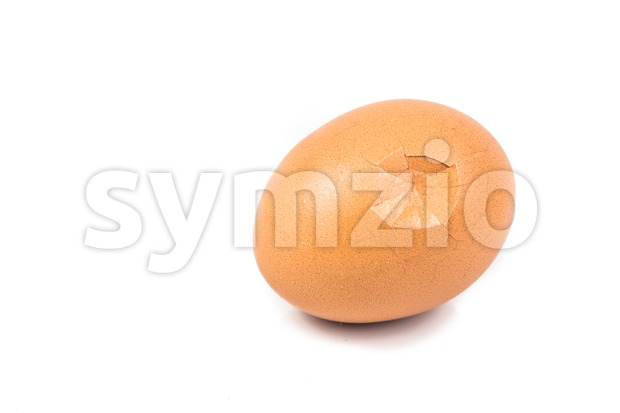 Egg with cracked egg shell isolated in white. Stock Photo