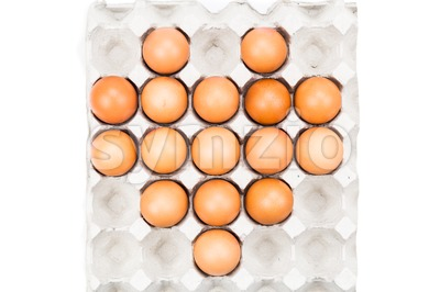 Heart shaped formation on tray with eggs. Stock Photo