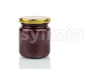 Organic strawberry jam in transparent glass jar Stock Photo