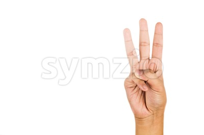 Hand gesturing number three against white background. Stock Photo
