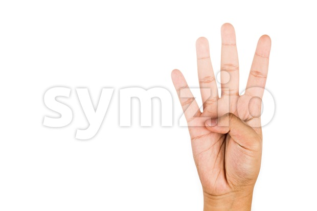 Hand gesturing number four against white background. Stock Photo
