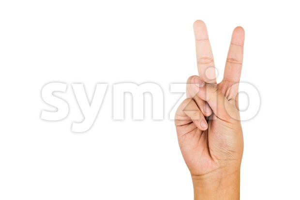 Hand gesturing number two against white background. Stock Photo