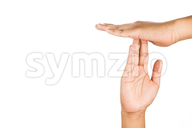 Hand gesturing time-out, against white background. Stock Photo