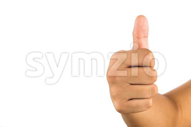 Hand with thumb up against white background. Stock Photo