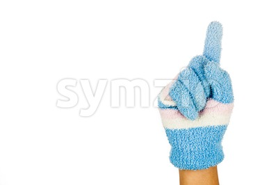 Hand in blue winter glove gesture number one against white background. Stock Photo