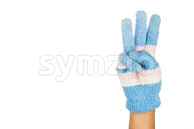 Hand in blue winter glove gesture number three against white background. Stock Photo