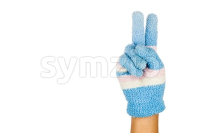 Hand in blue winter glove gesture number two against white background. Stock Photo
