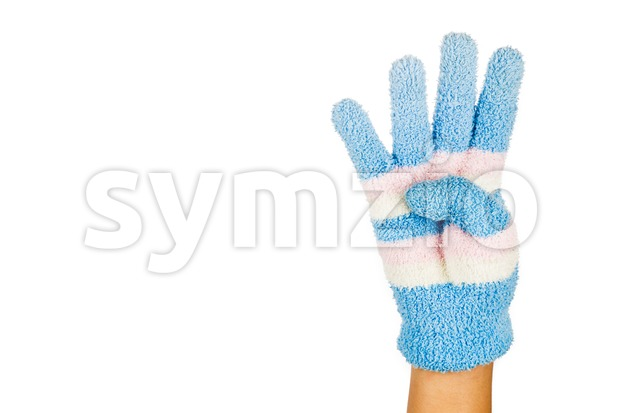 Hand in blue winter glove gesture number four against white background. Stock Photo