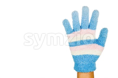 Hand in blue pink winter glove gesture number five against white background. Stock Photo