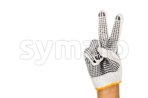 Hand in industrial glove gesturing number two against white background. Stock Photo