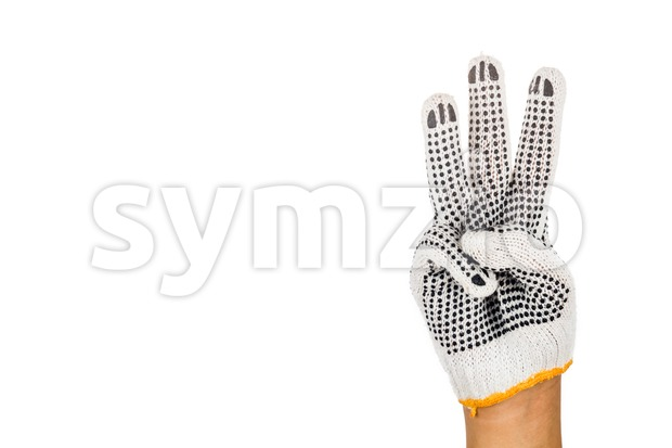 Hand in industrial glove gesturing number three against white background. Stock Photo