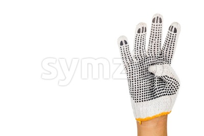 Hand in industrial glove gesturing number four against white background. Stock Photo