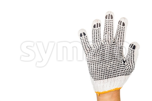 Hand in industrial glove gesturing number five against white background. Stock Photo