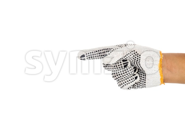 Hand in industrial glove pointing direction against white background. Stock Photo