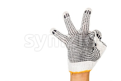 Hand in industrial glove gesturing OKAY against white background. Stock Photo
