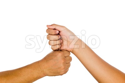 Vertical fist bump gesturing an agreement and cooperation. Stock Photo