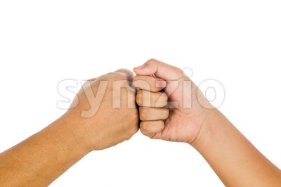 Fist bump gesturing an agreement and cooperation. Stock Photo
