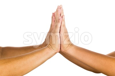 High-ten gesture by two person celebrating achievement. Stock Photo