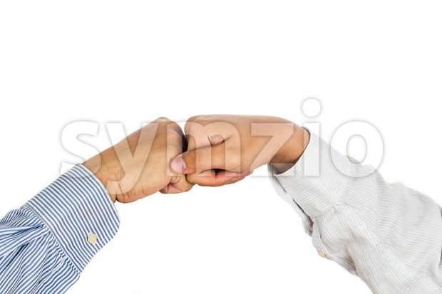 Fist bump on formal wear, gesturing an agreement and cooperation. Stock Photo