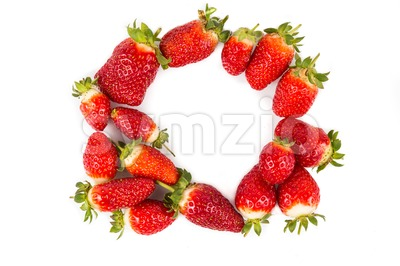 Heaps of strawberries form heart shape on white background Stock Photo