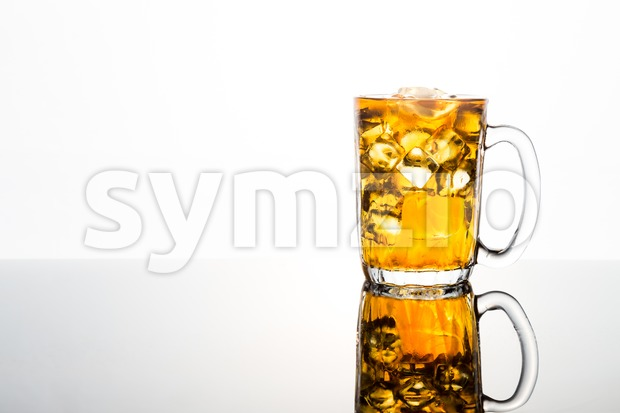 Refreshing ice cold tea in transparent glass